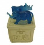 Blue Rhino and Elephant Standing on Treasure Box
